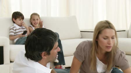 play : Footage in high definition of family relaxing in living-room