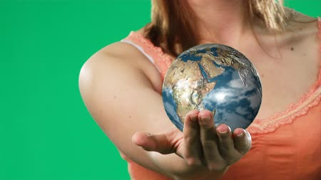 экономить : HD footage of an Attractive lady holding the world in her hands-4