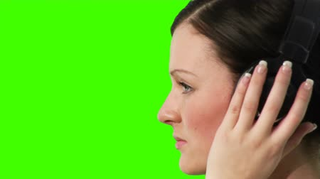 biodro : Chroma-Key high Definition Footage of a young adult listening to music