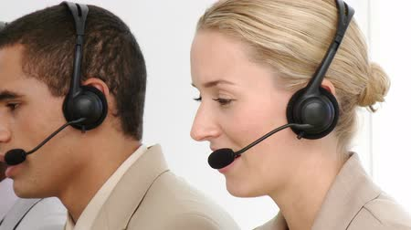 clientes : Multi-etnic business team working in a call centre in a company Vídeos