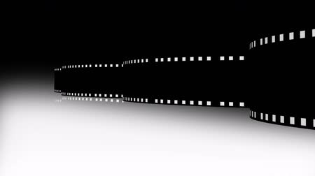 фотосъемка : Animation of a film reel announcing a movie. Cinema film Стоковые видеозаписи