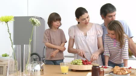 kahvaltı : Family preparing a healthy breakfast in the kitchen. Concept of nutrition and healthcare. Footage in high definition