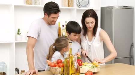 family life : Family working in the kitchen and enjoying healthy Food Stock Footage