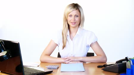 munkás : Thoughtful attractive young businesswoman working in office with laptop and documents footage