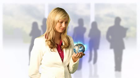 natural world : Young Woman Holding a 3d roating earth in her hand. Good for environmental concepts and also world business concepts. Stock Footage