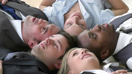 stres : Footage of Business team relaxing on floor in office with their heads together. Concept of non stress