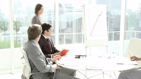 консультант : Business people interacting in a meeting with each other in high definition