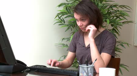 disinterest : Tired woman working at a computer at home Stock Footage