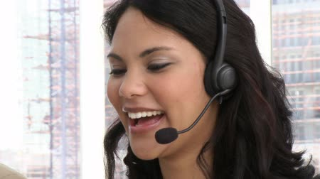temsilci : Laughing customer service representative at work Stok Video