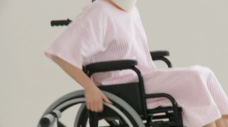 рука : Footage in high definition of beautiful female patient in a wheelchair
