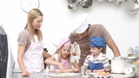 mutfak : Children baking cookies with their parents in the kitchen. Footage in high definition
