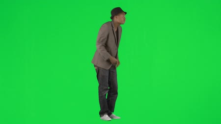 biodro : Ethnic young man dancing modern dance footage against green screen in high definition
