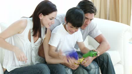 eğlence oyunları : Young Family playing video Games at home Stok Video