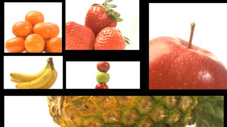 vitamin : A collage of fresh fruit in motion on a film reel -3 Stock mozgókép