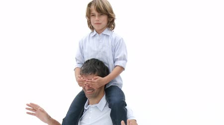 otec : Close-up of father giving son piggyback ride and playing with him. Footage in high definition Dostupné videozáznamy