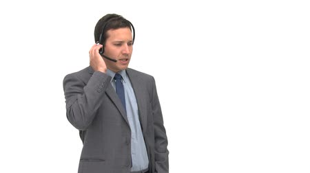 earpiece : Charismatic businessman explaining something against a white background