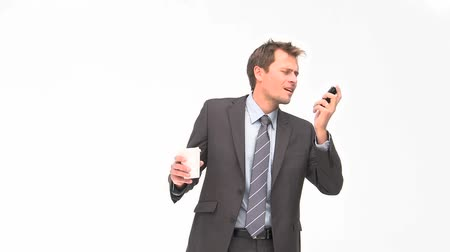 colarinho branco : Businessman phoning while he is drinking coffee against a white background