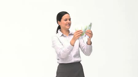 жадный : Businesswoman loving her money against a white background