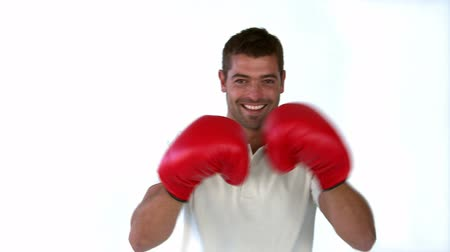 puncs : Man with boxing gloves in front of the camera against a white background