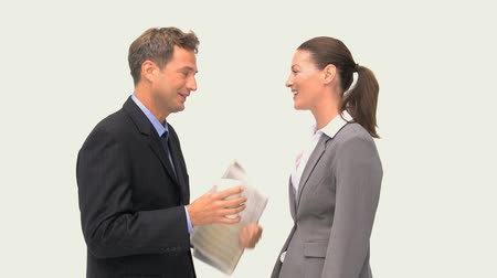discussão : Happy coworkers laughing together against a white background Stock Footage