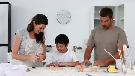 culinária : Family cooking together at home in the kitchen