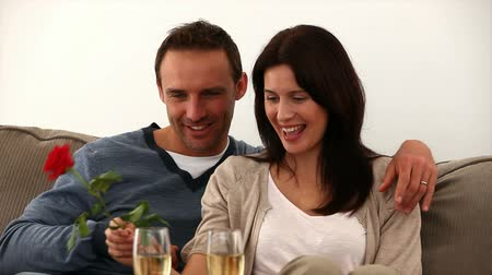 namoro : Couple toasting with white wine on the sofa  Stock Footage