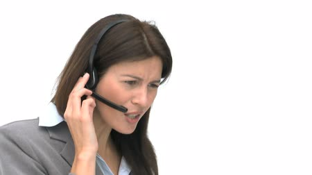 clientes : Angry businesswoman talking with headphones isolated on a white background