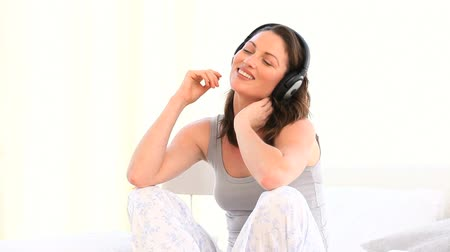superb : Superb woman listening music against a white background