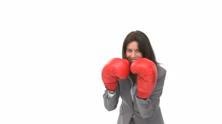 bokszoló : Happy businesswoman with boxing gloves against a white background