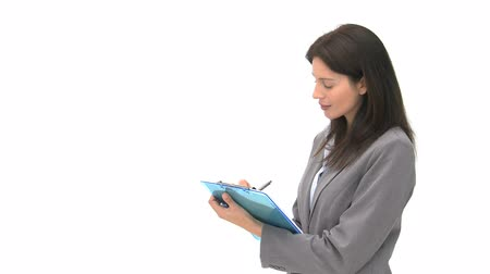 titkár : Smiling businessman writting on her notebook against a white background