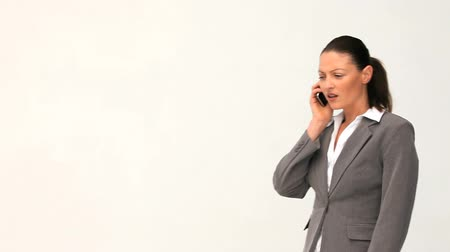 kobieta biznes : Businesswoman talking on the phone against a white background
