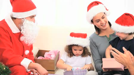 razem : Santa Claus looking at children with their gifts
