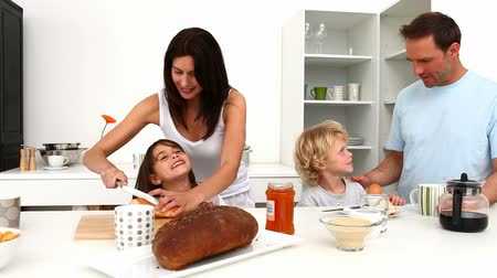 хлеб : Family having breakfast together in the kitchen at home