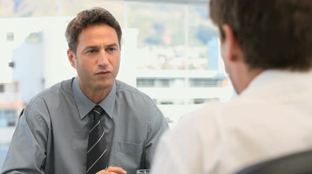 Manager talking with an employee in his office