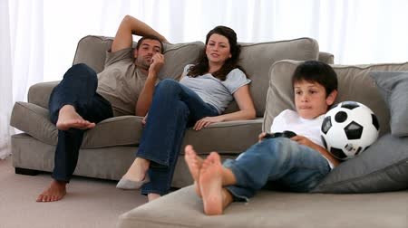 guy home : Family playing together on the sofa Stock Footage