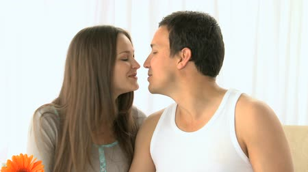 nutrição : Woman kissing her boyfriend and drinking orange juice isolated on a white background