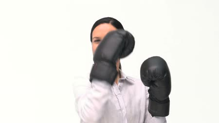 glove : Beautiful woman with black boxing gloves agaisnt a white background
