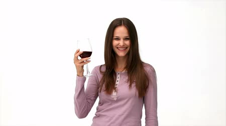 kırmızı şarap : Happy woman drinking a red wine isolated on a white background