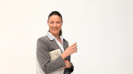 üzleti öltöny : Beautiful businesswoman with a drink