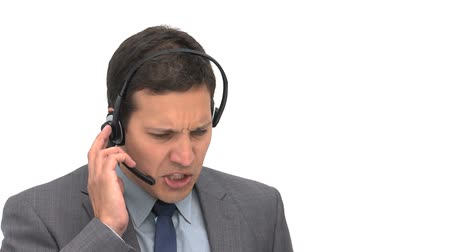 temsilci : Angry businessman on the phone with earpiece against a whit background