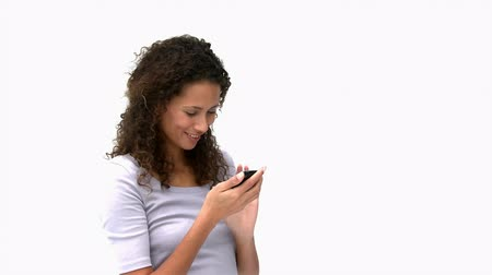smartfon : Woman using a smartphone against a white background