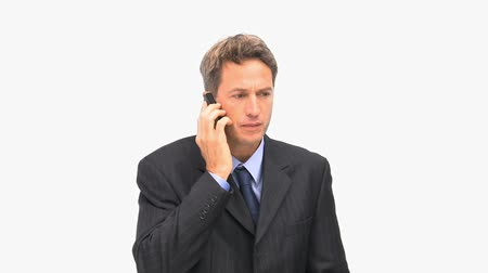 colarinho branco : Businessman having a dispute on the phone against a white background Stock Footage