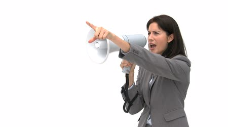 мегафон : Businesswoman shouting through megaphone isolated on a white background Стоковые видеозаписи