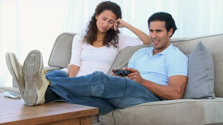 unott : Desperate woman being bored while her boyfriend is playing a video game