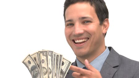 финансы : Smiling man pointing dollars against a white background