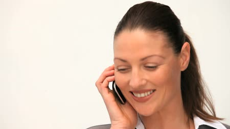 colarinho branco : Businesswoman talking on the phone against a white background
