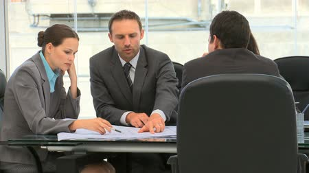четыре человека : Business people working together on a document during a meeting in an office