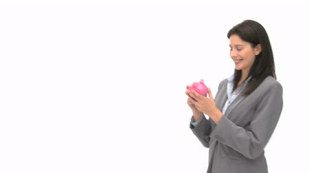 монета : Businesswoman holding a piggy bank against a white background