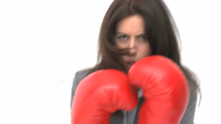 bokszoló : Serious businesswoman with boxing gloves against a white background
