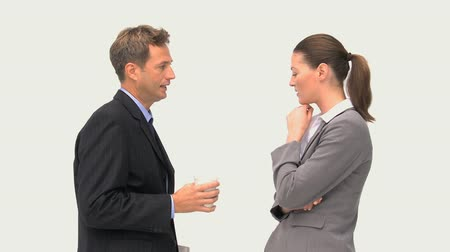 elnök : Businessman talking with a businesswoman against a white background